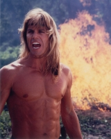 Tarzan in front of fire